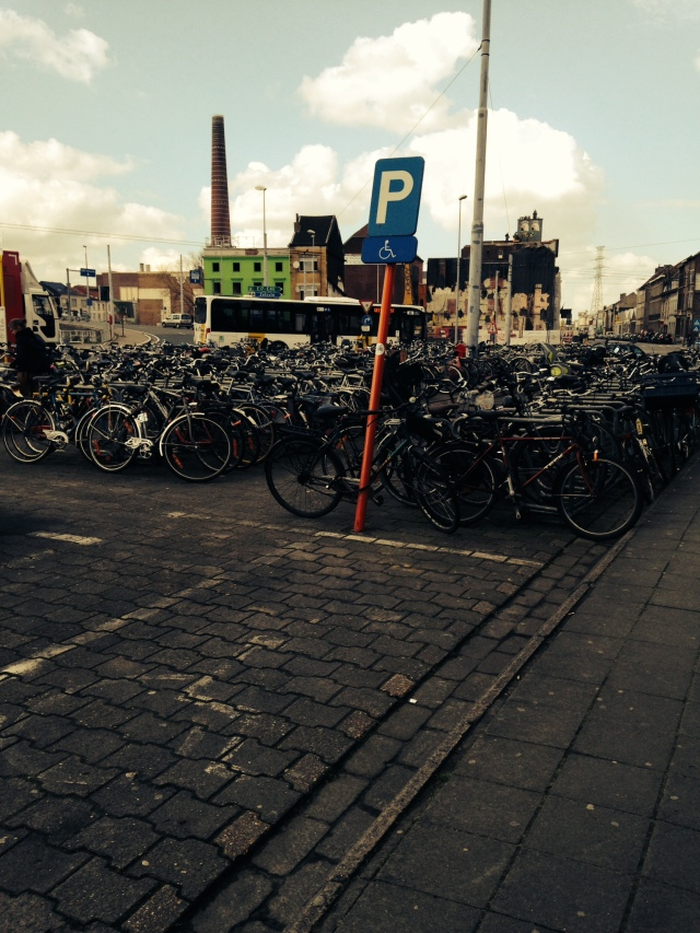 a parking lot for bikes in ghent. I have never seen anything like it!