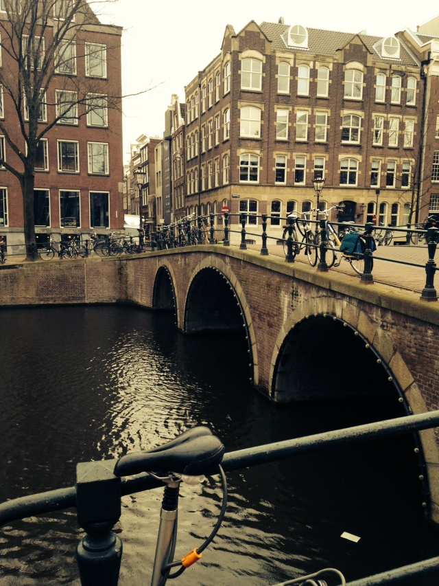 one of the city's many bridges. one of europe's three canal cities (venice and bruges are the other two), there's water everywhere in amsterdam.