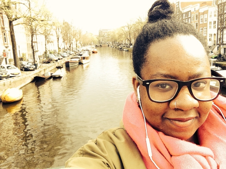 in front of one of the canals in amsterdam. I'm still plotting how to return to that beautiful place.